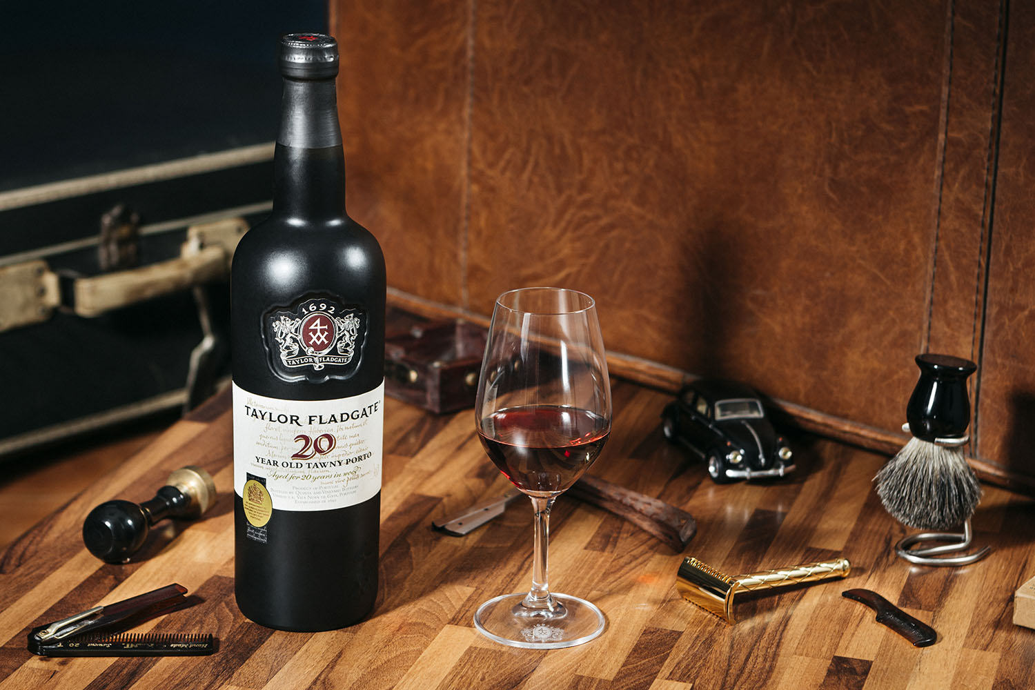 a glass of taylor fladgate port next to a bottle