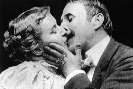 May Irwin and John C Rice stars of the Broadway play 'The Kiss', reenact the play's famous kissing scene for the Edison Company's cameras.