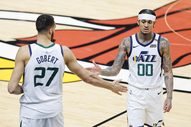 Rudy Gobert #27 and Jordan Clarkson #00 of the Utah Jazz high five against the Miami Heat