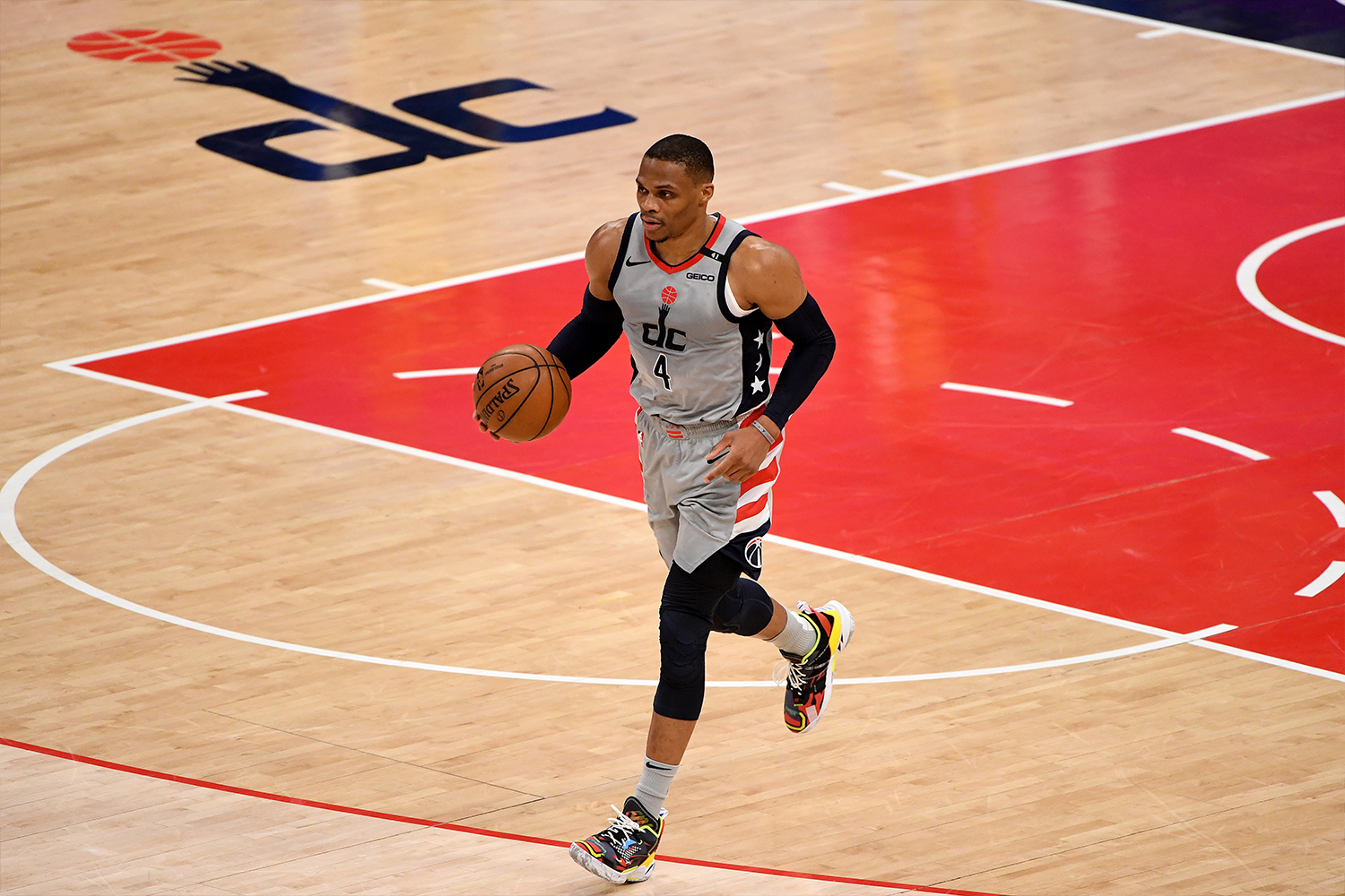 Russell Westbrook #4 of the Washington Wizards dribbles against the Golden State Warriors