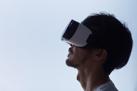 A man wearing a virtual reality headset. Could VR help with curing PTSD?