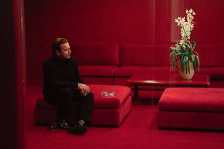 Halston (portrayed by Ewan MacGregor) admires one of his precious orchids in the new Netflix series on his life and career