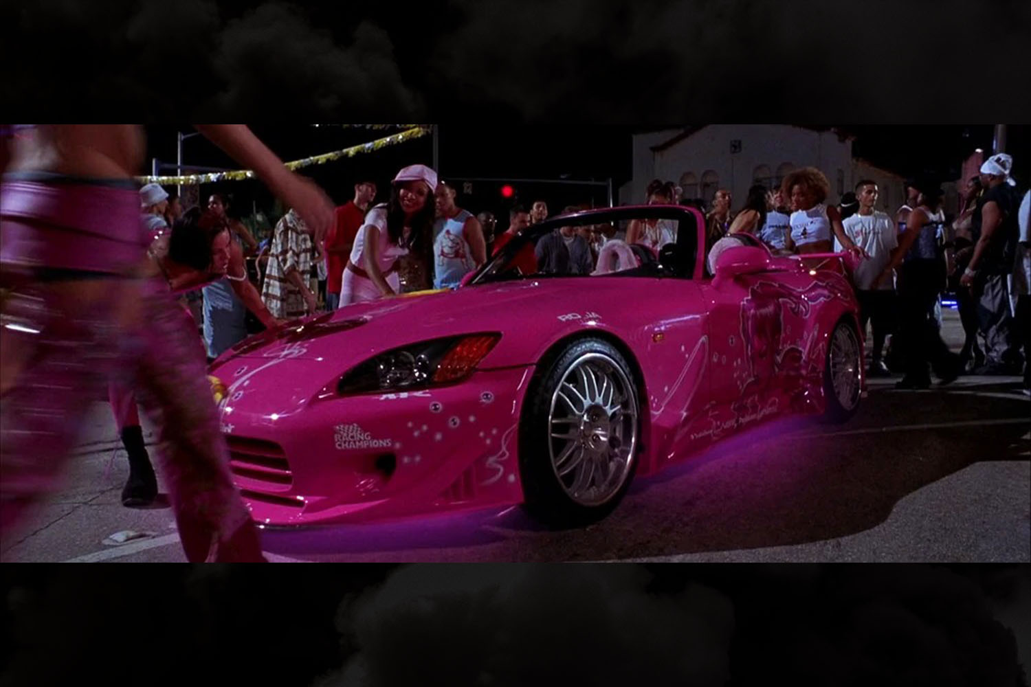 Suki's pink 2000 Honda S2000 from 2 Fast 2 Furious with underglow lighting is one of our favorite from the Fast and Furious franchise