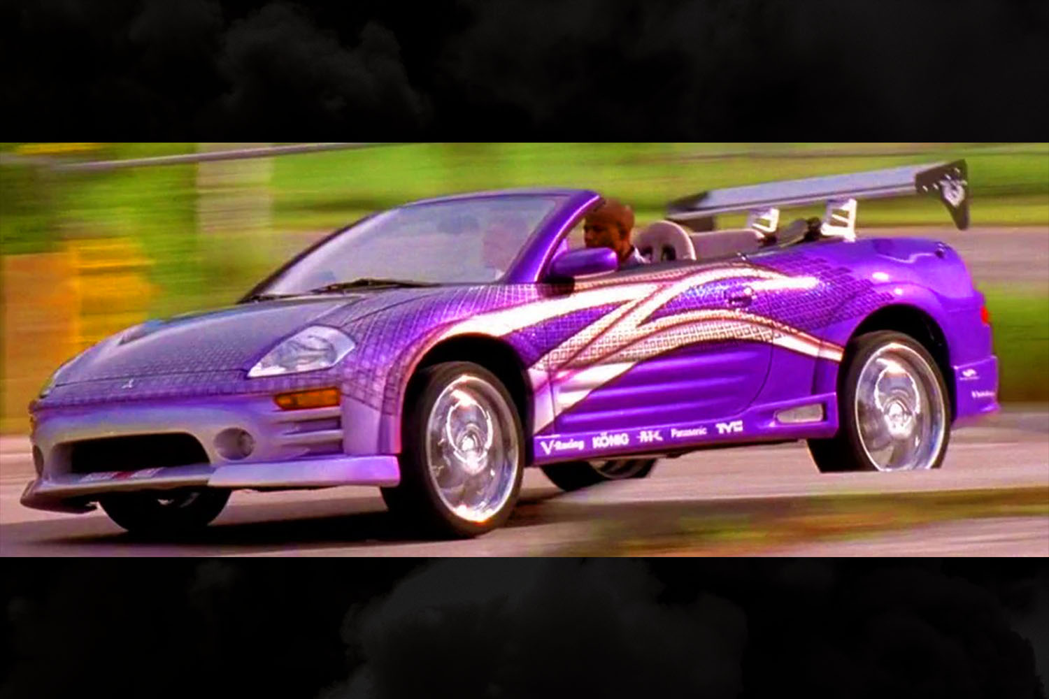 Roman Pearce (Tyrese Gibson) driving an electric purple 2003 Mitsubishi Eclipse Spyder GTS in 2 Fast 2 Furious