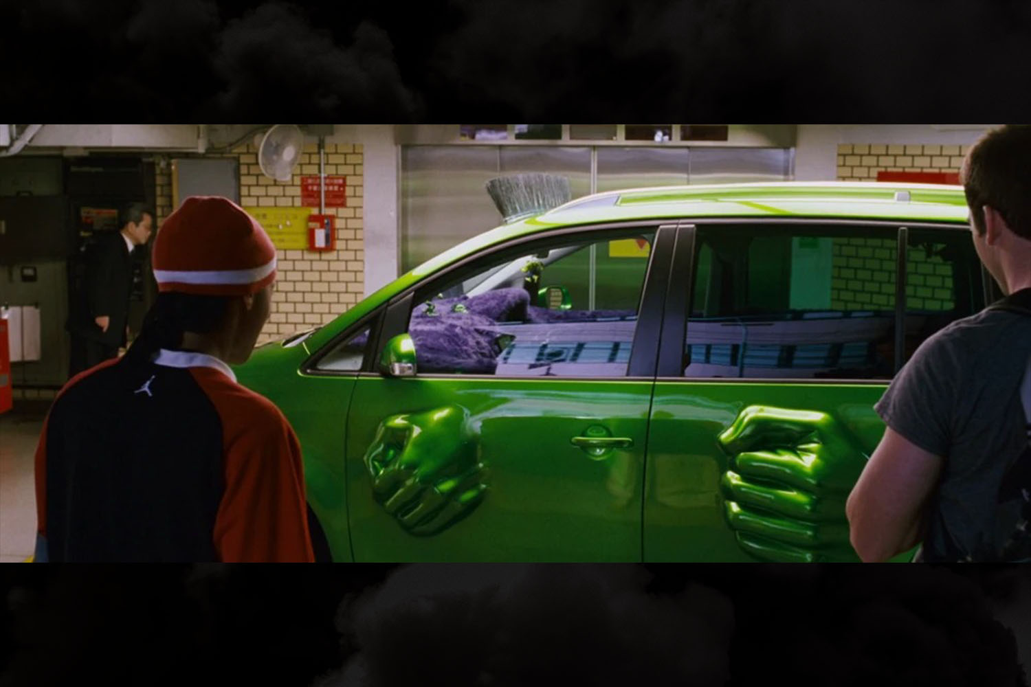 Hulk fists smashing through the doors of the mean green 2005 Volkswagen Touran owned by Twinkie (Bow Wow) in The Fast and the Furious: Tokyo Drift