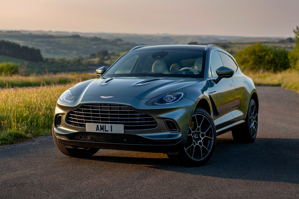 The 2021 Aston Martin DBX SUV in green in the countryside
