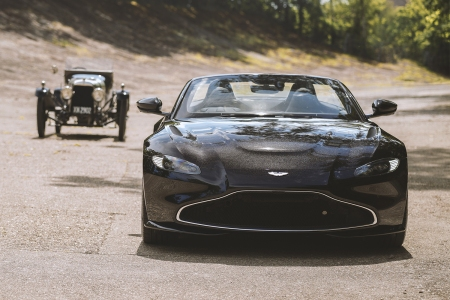 A new Aston Martin Vantage Roadster flanked by the A3, the British marque's oldest surviving car. The Vantage is an anniversary tribute to the 1921 car.