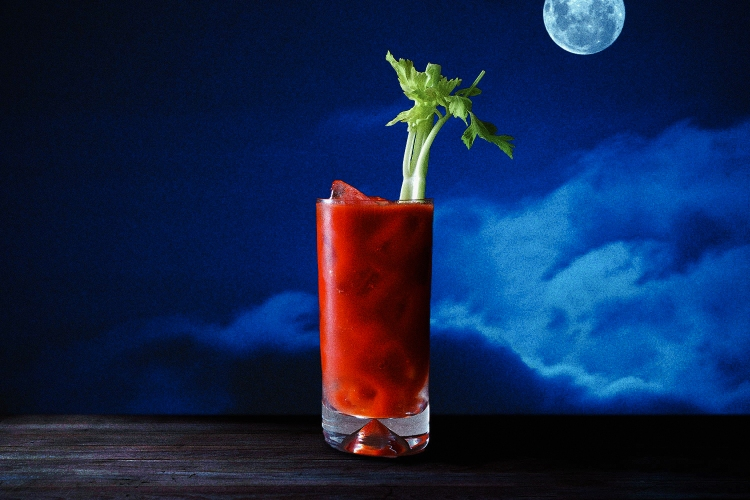 a Bloody Mary in front of a full moon