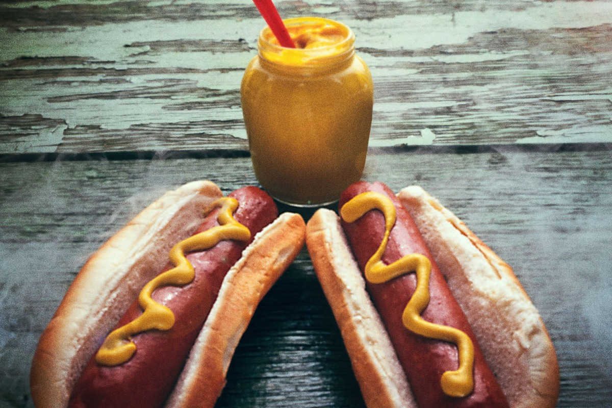 Two steaming hot dogs