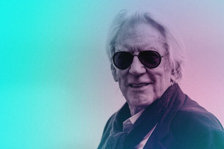 Donald Sutherland in a pair of aviator sunglasses and a wool scarf, two hallmarks of his inimitable approach to men's style