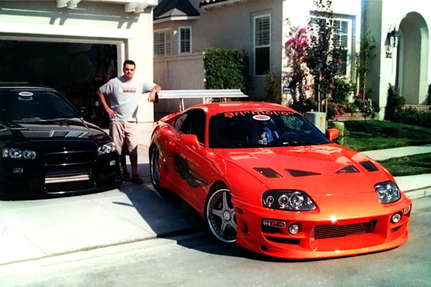 Craig Lieberman, technical advisor on the first two Fast and Furious movies, standing next to his orange Toyota Supra