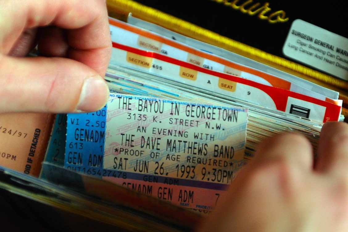 A collection of old concert tickets, including a Dave Matthews Band ticket from 1993