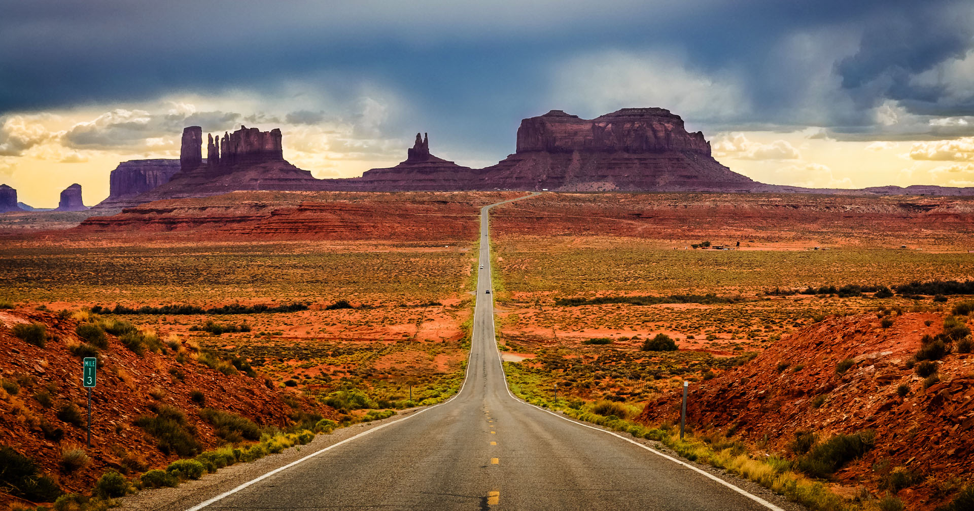Highway 163 through Monument Valley is one of the most scenic drives and road trips in America, as evidenced by this view of the towering sandstone buttes in the Navajo Valley Park in Arizona.