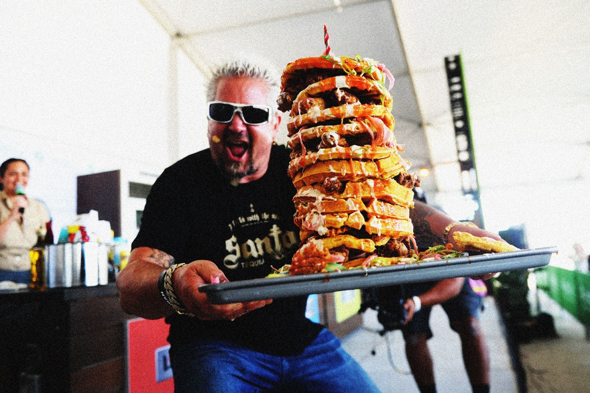 Guy Fieri doing his take on chicken and waffles at the South Beach Wine and Food Festival