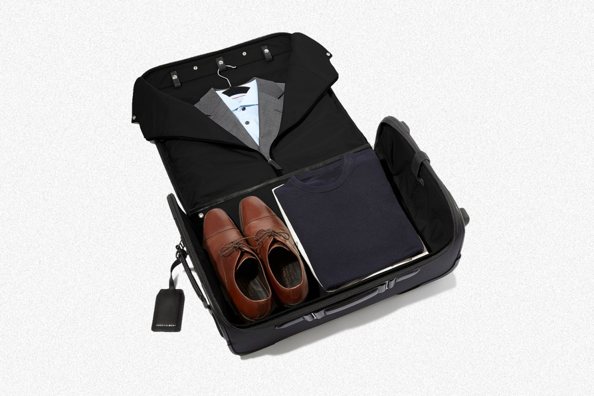 A Garment Luggage Carry-On from Hook & Albert opened to show a suit