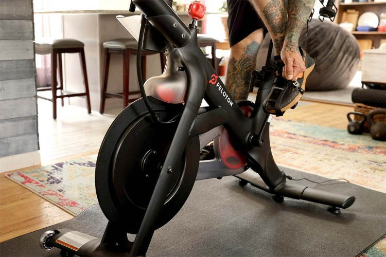 A detail of Brody Longo strapping his foot into his Peloton exercise bike pedal before he works out on April 16, 2021 in Brick, New Jersey