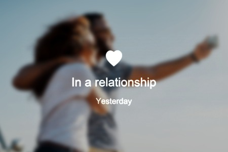 """Blurred photo of a couple, text overlay reads """"in a relationship"""""""