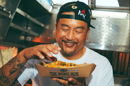Roy Choi stares with glee at the Kogi Dog.