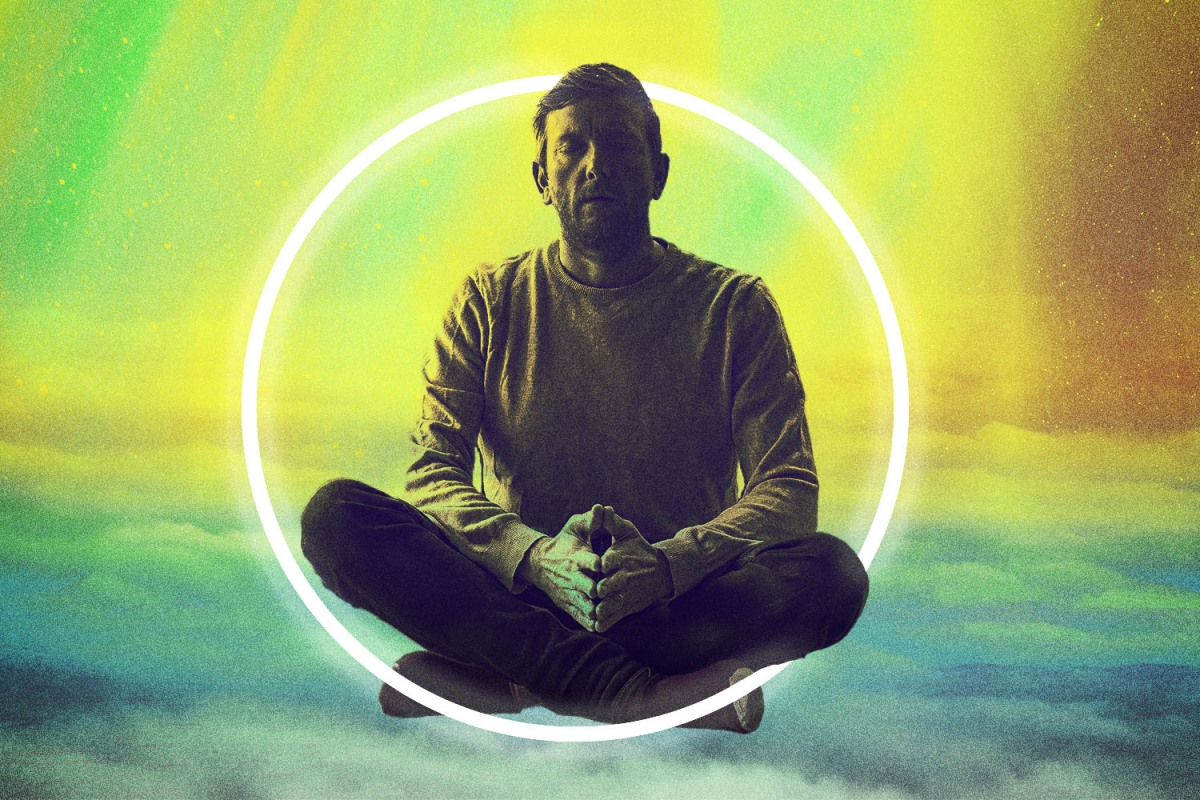 """a man practicing transcendental meditation, which practitioners often say """"changed their life"""""""