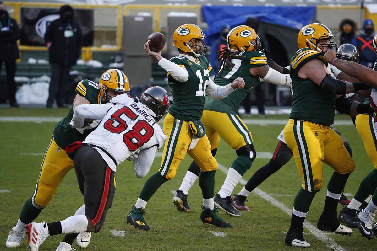 NFL Playoffs: Green Bay Packers QB Aaron Rodgers (12) in action, passing vs Tampa Bay Buccaneers at Lambeau Field. Green Bay, WI 1/24/2021