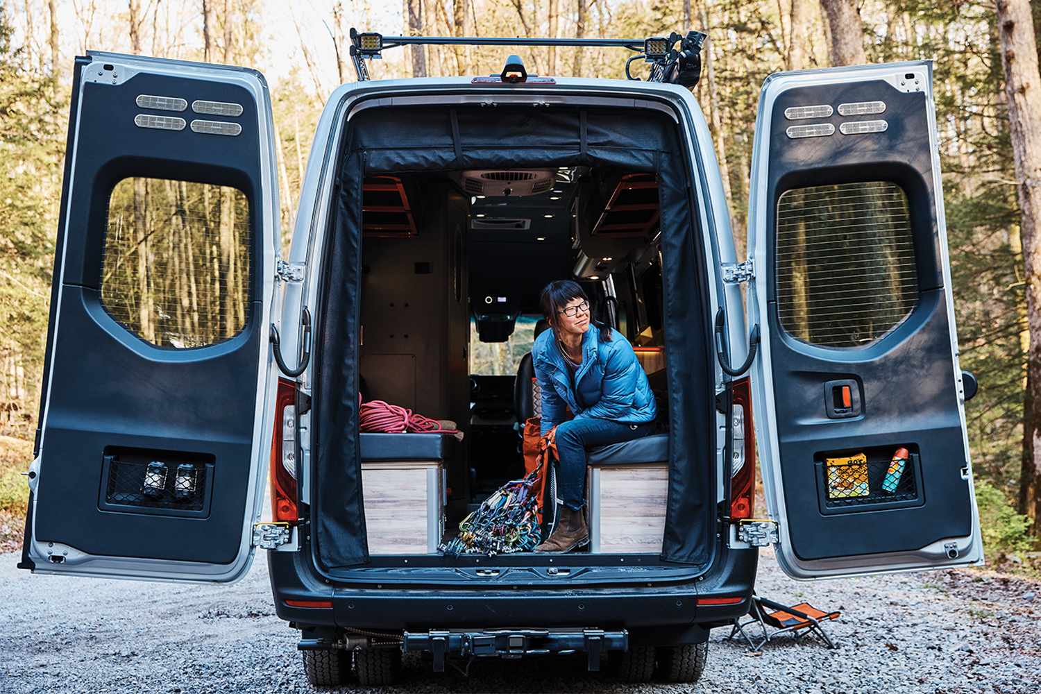 A person sitting in the back of the Airstream Interstate 24X adventure van