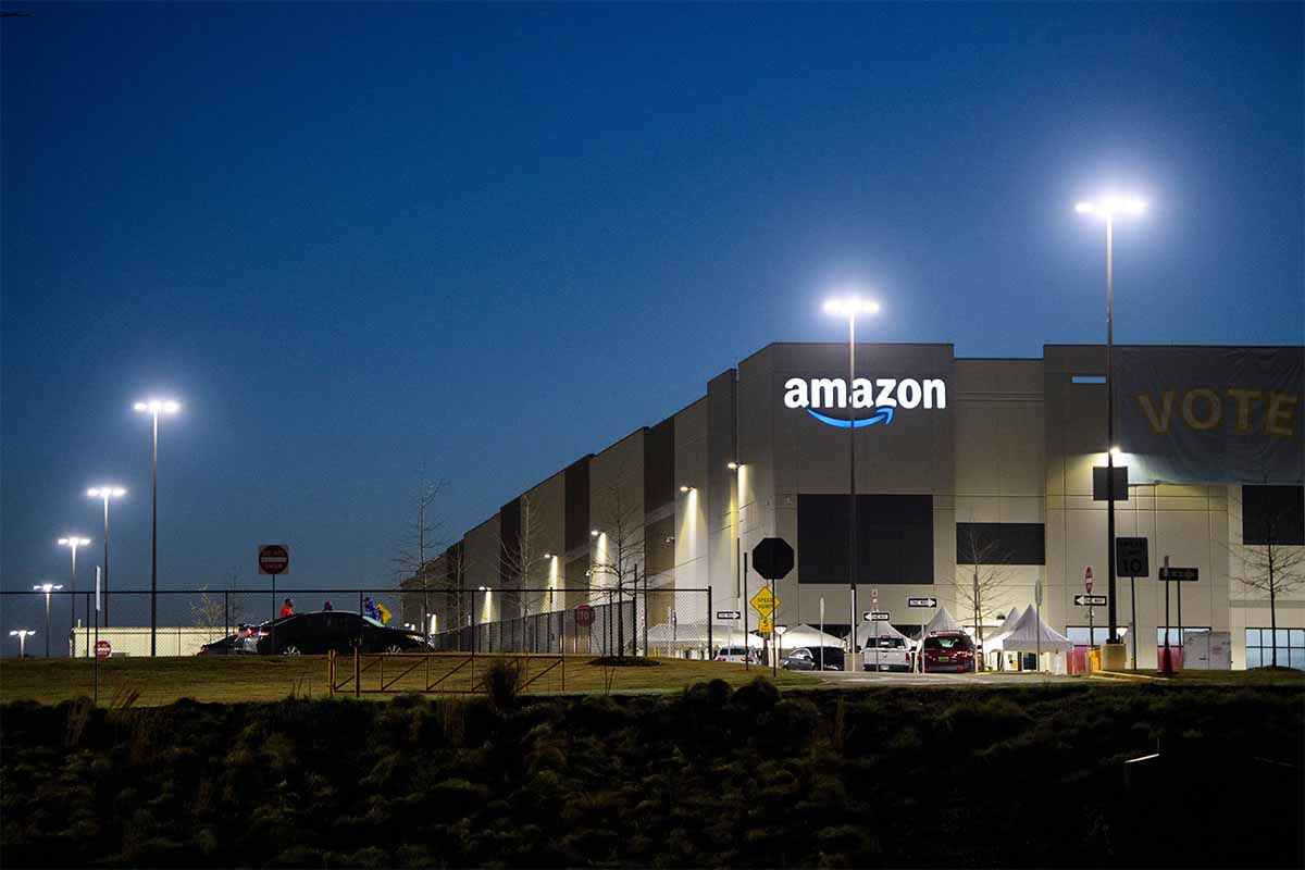 The Amazon.com, Inc. BHM1 fulfillment center is seen before sunrise on March 29, 2021 in Bessemer, Alabama