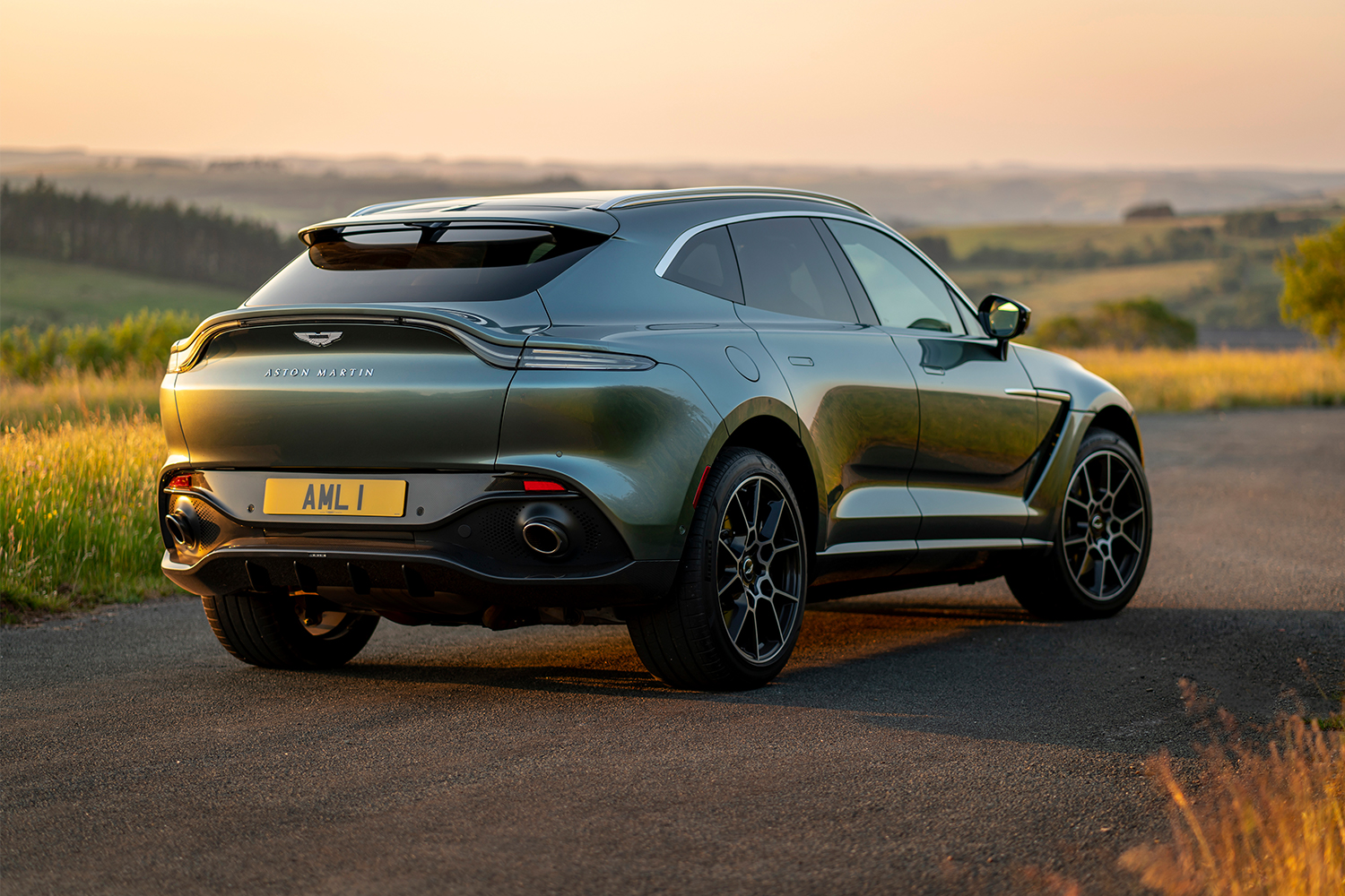 The back end of a 2021 Aston Martin DBX SUV in the country