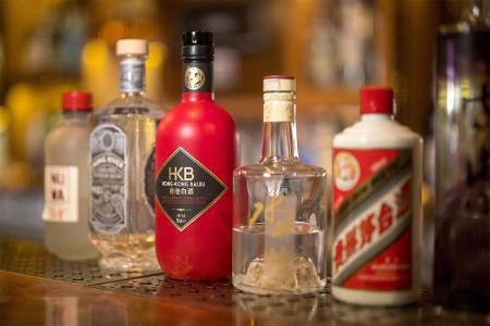 Bottles of Baijiu Chinese spirit are displayed at a bar in central London on May 15, 2019