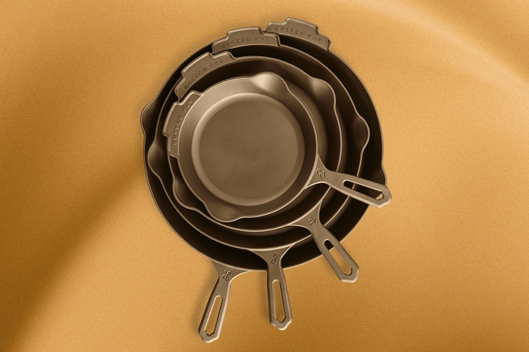 A stack of cast iron pans from Butter Pat Industries on a gold background