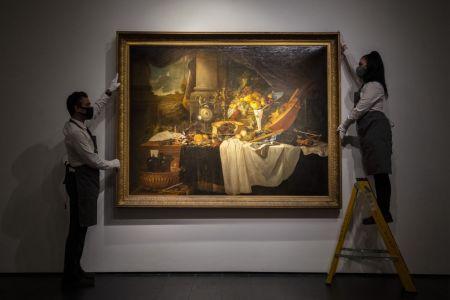 """""""A banquet still life"""" by Jan Davidsz De Heem being hung on a wall"""