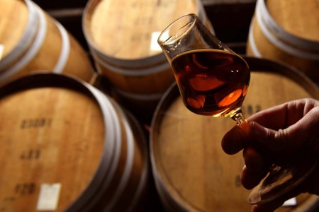 The cellar master checks the quality of an aged Armagnac at the Chateau Laubade, in Sorbets, near Eauze, in the department of the Gers, south western France, on February 9, 2021.