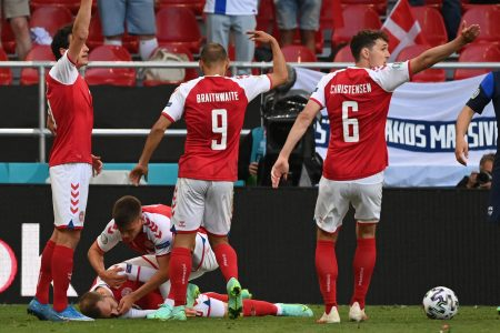 Players help Denmark midfielder Christian Eriksen