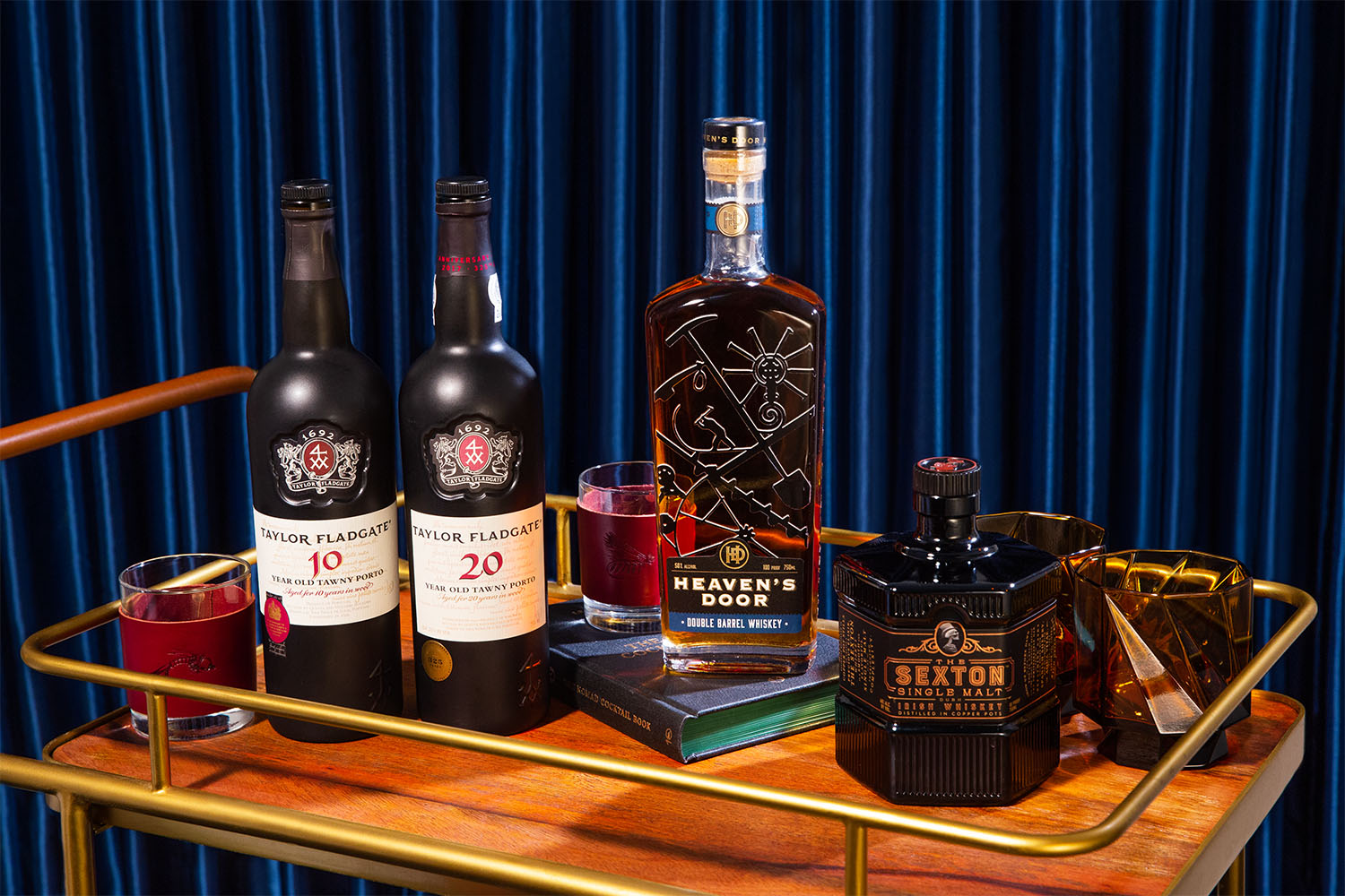 taylor fladgate port, heaven's door whiskey and sexton single malt on a barcart