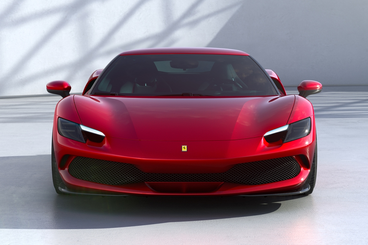 The front end of the red Ferrari 296 GTB, a new plug-in hybrid car from the Italian marque.