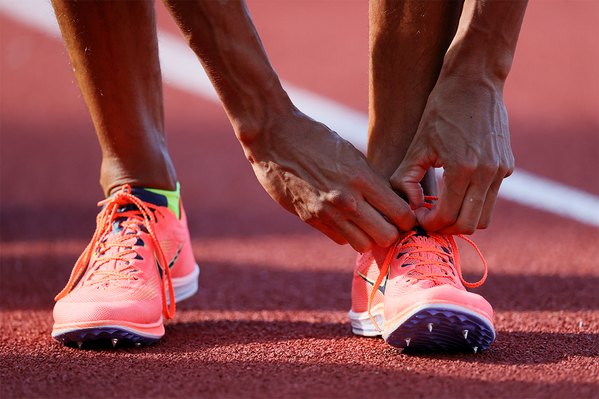 Nike Dragonfly track spikes being laced up