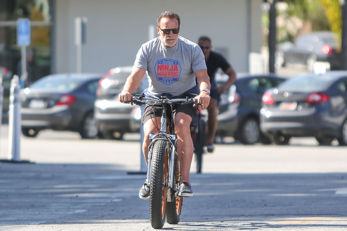 Arnold Schwarzenegger biking. The actor recently discussed his secrets for staying energetic at 73.