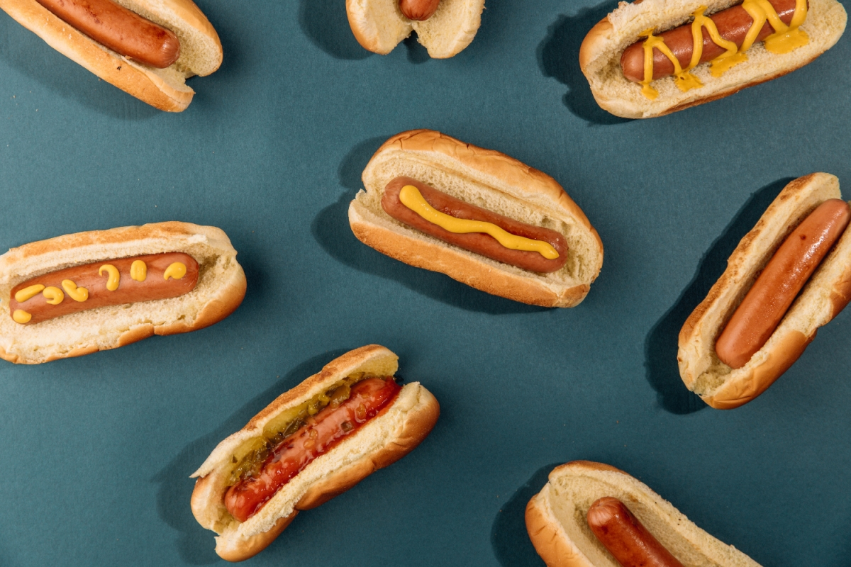 hot dogs on blue background