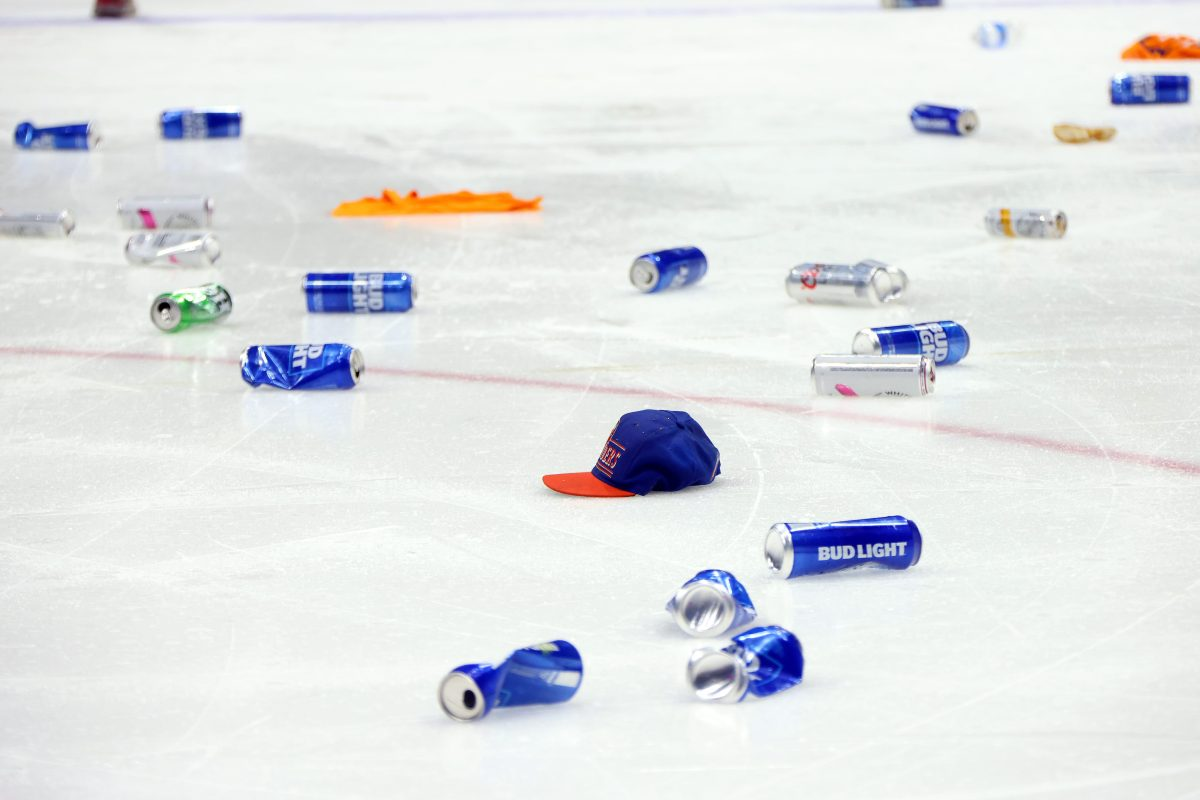 The ice at Nassau Coliseum covered in beer cans following the New York Islanders win on Wednesday night