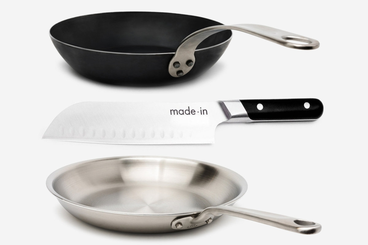 A blue carbon steel frying pan, Santoku kitchen knife and stainless steel pan from Made In Cookware, all of which are on sale
