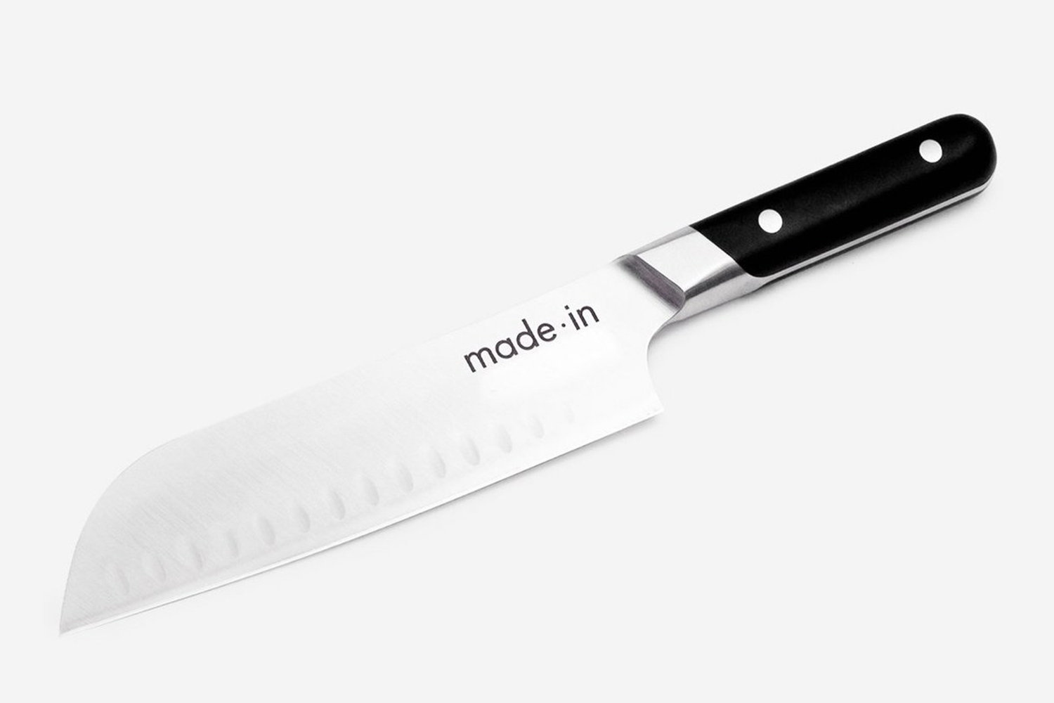 The Santoku Knife from Made In Cookware featuring a sheepsfoot blade and flat cutting plane