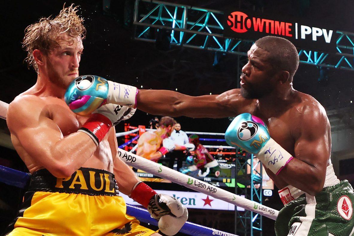 Floyd Mayweather punches Logan Paul