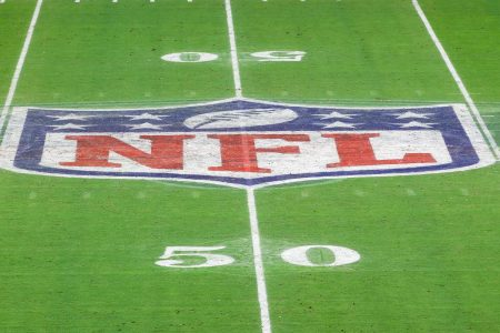The NFL logo on the field of State Farm Stadium in. Arizona.