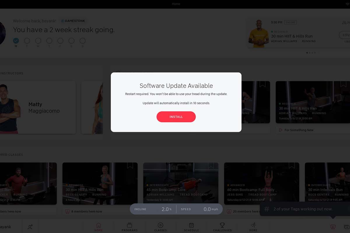 A screen with a mandatory Peloton software update