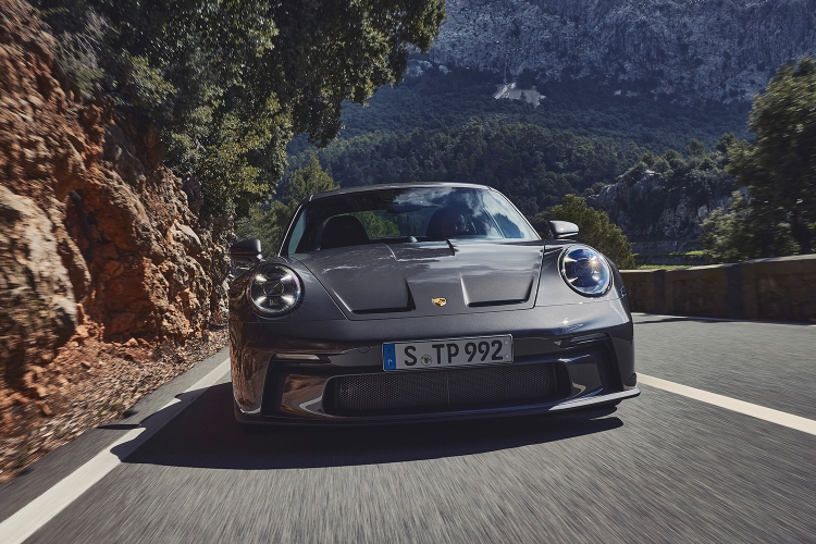 The new Porsche 911 GT3 with Touring package driving a scenic road