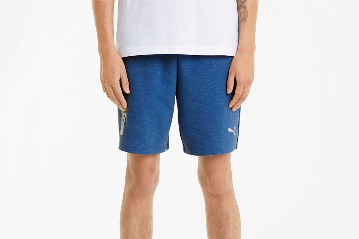 A man wearing Porsche Legacy Men's Sweat Shorts, now on sale at PUMA