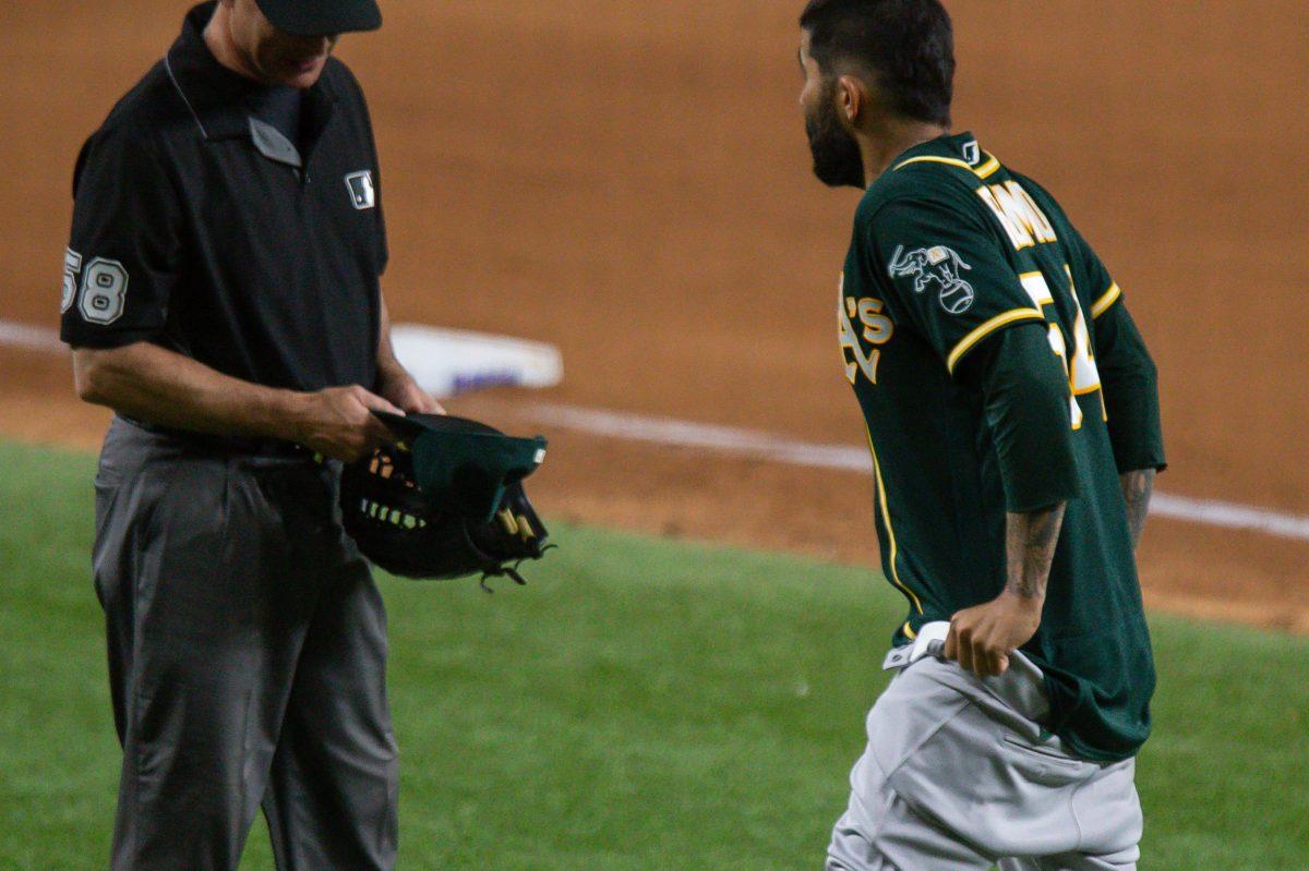 Oakland Athletics Pitcher Sergio Romo pulls down his pants.