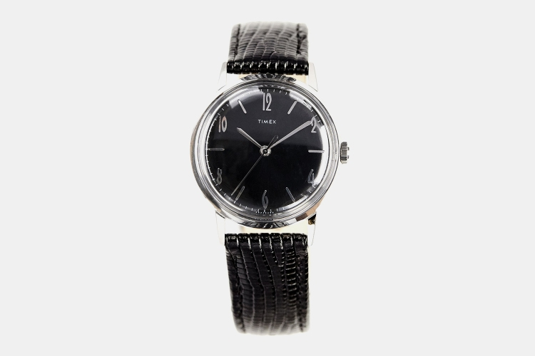 The hand-wound mechanical Timex Marlin watch, a 34mm timepiece with a black sunray dial exclusively available at Todd Snyder