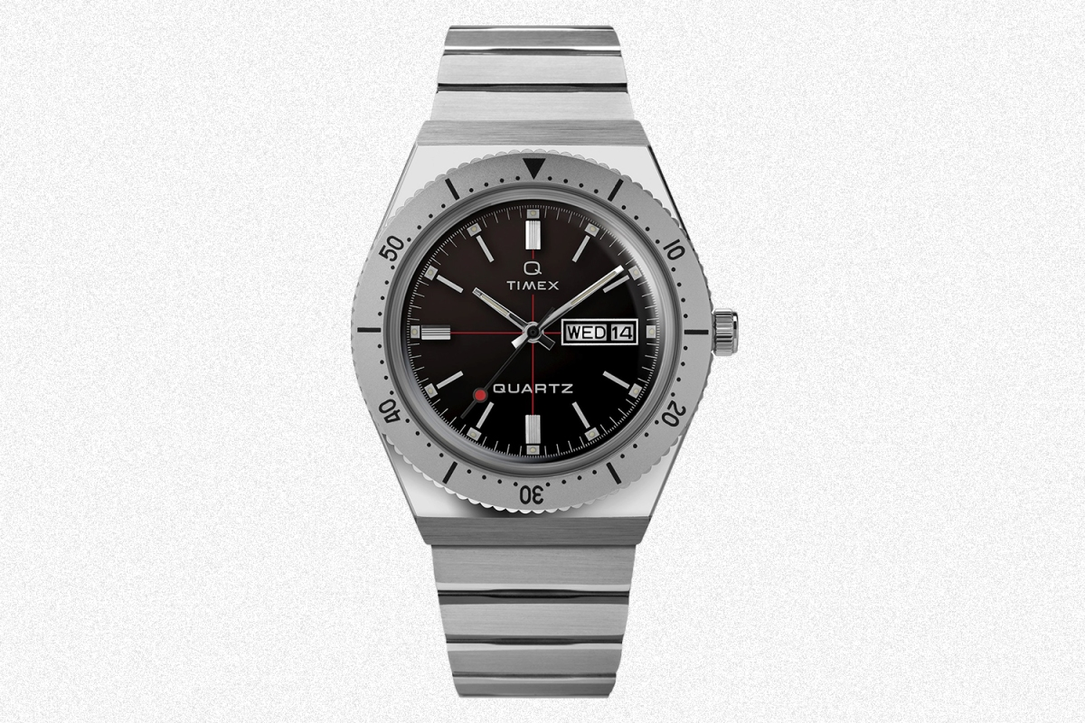 The Todd Snyder Q Timex watch on a grey background
