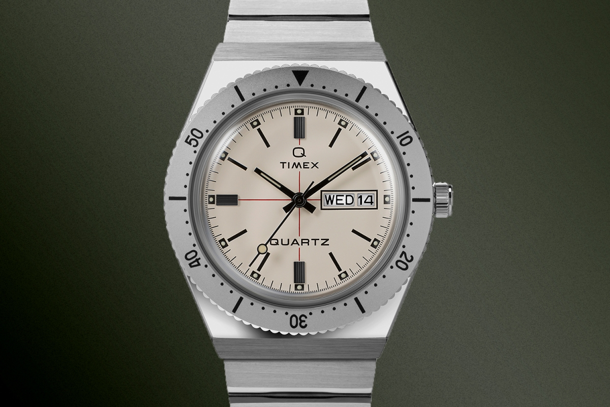 The new Q Timex watch collab from with Todd Snyder on a green background