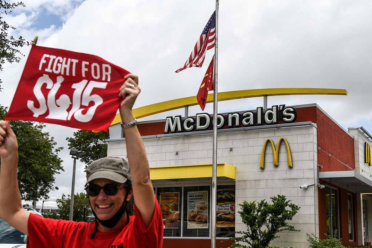 An employee of McDonald's protests outside a branch restaurant for a raise in their minimum wage to $15 an hour, in Fort Lauderdale on May 19, 2021